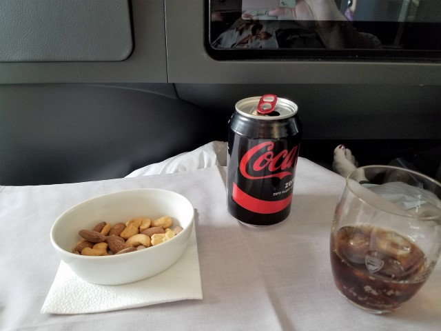 Shortly after take-off, they brought me a nice bowl of warmed assorted nuts and a soda - yum!