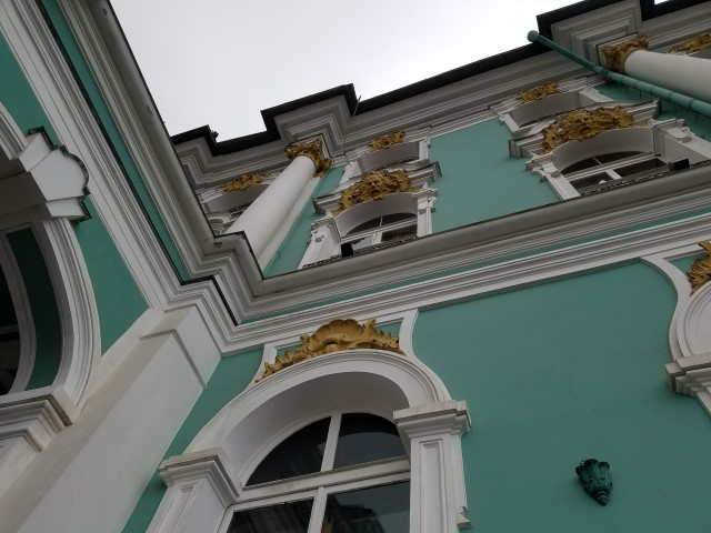 The yellow areas of the exterior of the building used to be covered in Gold Leaf - (like a lot of the interior) but they have not changed to a less extravagant paint scheme