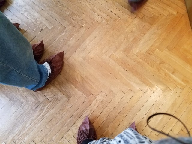 The floors are in need of protection - so we had to cover our shoes in booties